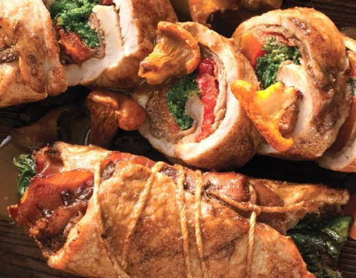 Pork can be cooked on a sheet pan with mushrooms and vegetables. Stuffed pork pieces are a delight when cooked this way.