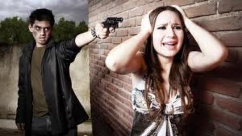 Mugger robbing girl.