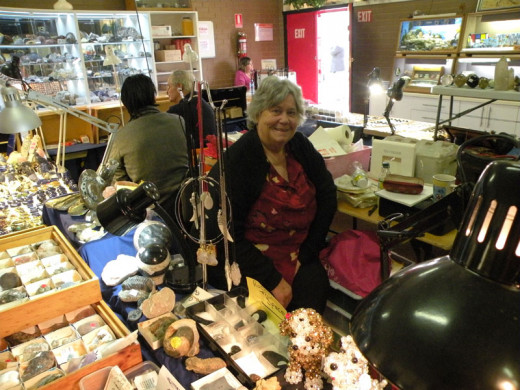 Nola with a variety of specimens and jewellery.