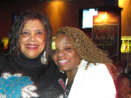 Paulette Blake, wife of Jerry Blake poses with an a family member of Point Blank.