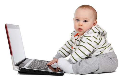 baby in front of computer