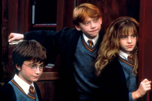 "Watson (right) makes her film debut, with Daniel Radcliff (left) and Rupert Grint (center) in ""Harry Potter and the Sorcerer's Stone"" (2001)"