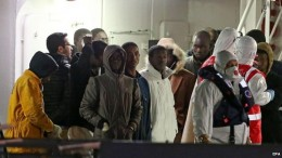This group of people here are the lucky few left, they have been saved from this the overloaded boat carrying over 700 people that sang very quickly after colliding with the rescuing larger boat that came to their aid.