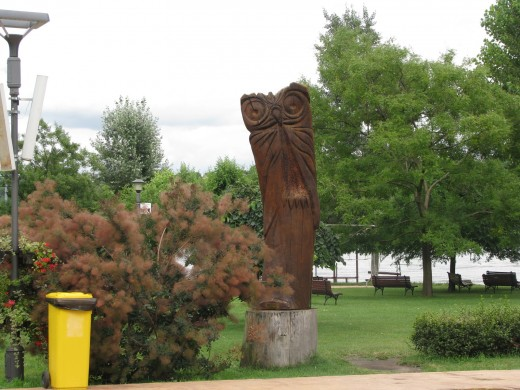 This wooden owl sculpture is one of many sculptures located throughout the park grounds of The Strand in Novi Sad.