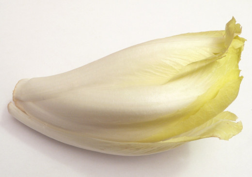 Belgian endive has a delicate white appearance and slight bitter taste that adds zing to salads. It can also be braised and fried for many savory dishes.