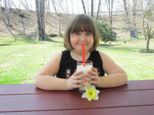 Olivia enjoying her milk shake