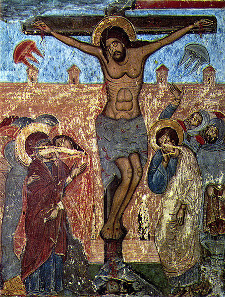 In this picture of the crucifixion on either side of the cross is what appears to be flying saucers.