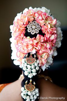 hair well decorated with flowers and jewellery
