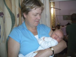 Newborn baby (12 hours old) with his proud grandmother in the same ward