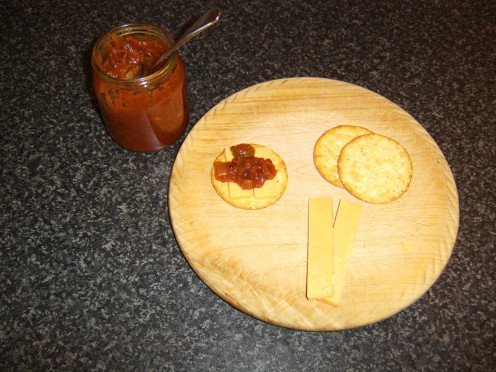 Homemade sweet tomato pickle on cheese and crackers