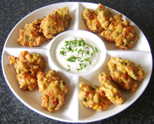 Herb garnish is added and fritters are ready to serve
