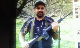 ...posing with a more high powered weapon than that of Chavez. Can we say hypocrite? #vote for Chavez