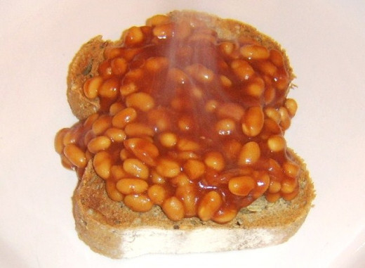 Beans are spooned on to hot toast