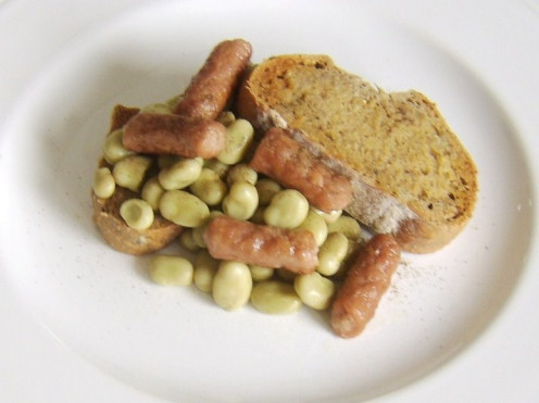 Broad beans and mini sausages on hot buttered toast