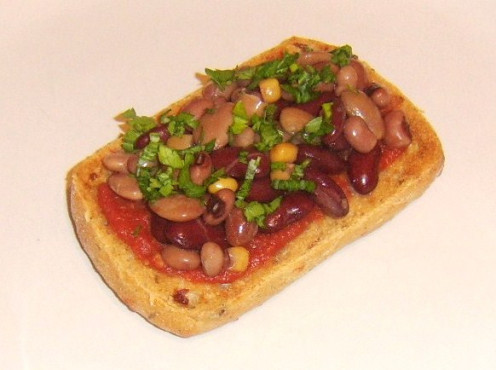 Italian bean combination and tomato sauce on toasted ciabatta