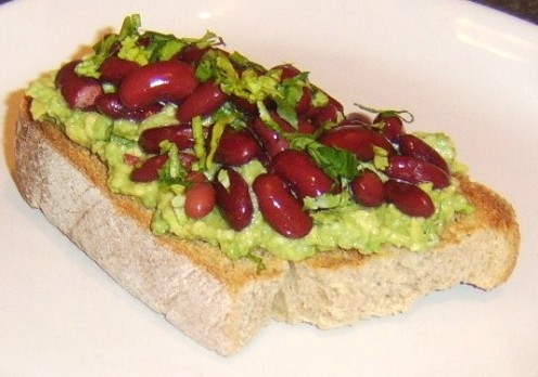 Homemade guacamole and red kidney beans are served on Oktoberfest boule toast
