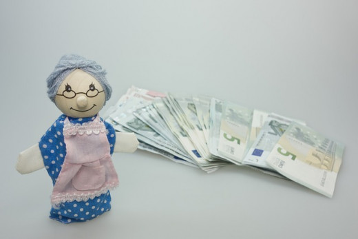 grandmother like doll with money next to her