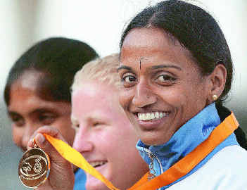 India's J. J. Shobha (right) accumulated 5884 points to clinch the heptathlon gold
