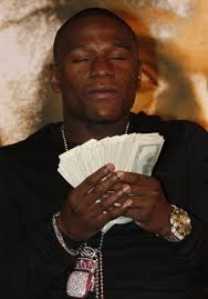 Mayweather with the thing he loves most
