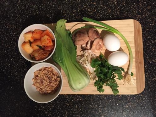 Fresh Ingredients: Radish/Napa Cabbage Kimchi, Fried Shallots, Bok Choy, Shiitake Mushrooms, Mung Bean Sprouts, Eggs, Cilantro, Green Onions.