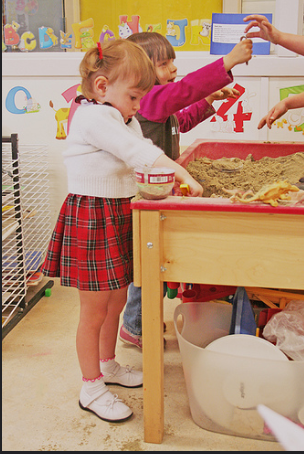 Playing at the sand table is an example of Developmentally Appropriate Practices.