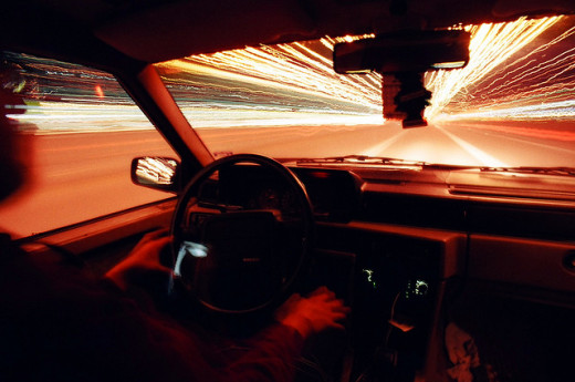 Driving at a high speed inside a Volvo.