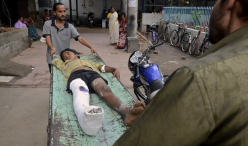 An injured boy is taken to a ward inside a hospital after an earthquake in Siliguri.