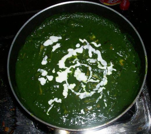 Fresh cream added to the Palak Paneer