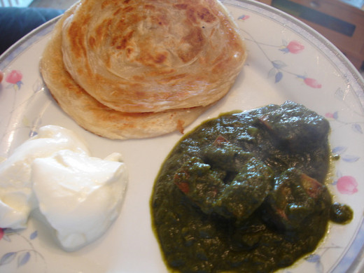 Served with paratha and dahi (curd)