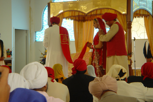 Sikh Wedding By Ashish 100 [CC-BY-2.0 (http://creativecommons.org/licenses/by-sa/3.0/0], via Wikimedia Commons
