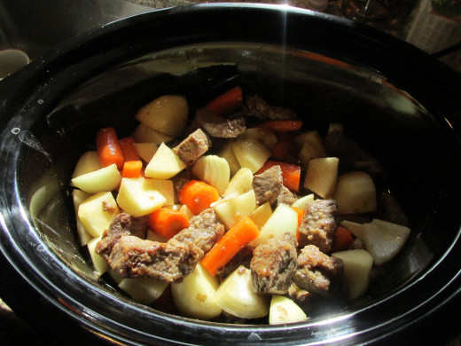 All ingredients in the slow cooker before it's done.