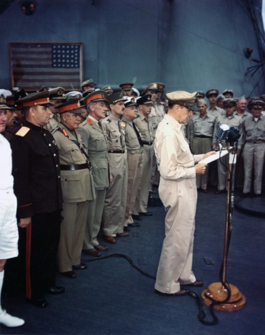 General Douglas MacArthur formally accepting Japan's surrender on board the USS Missouri (September 2nd 1945).