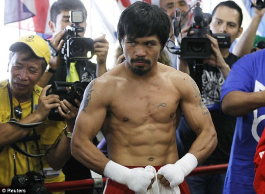 Manny Pacquiao shows off his physique during training for his fight before with Shane Mosley.