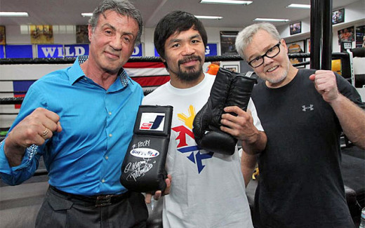 Sylvester Stallone surprised Manny Pacquiao with his visit and had his Rocky Balboa gloves signed by the champ.