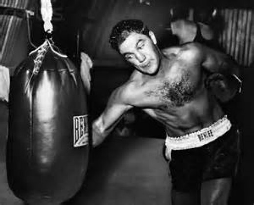 Rocky Marciano retired as heavyweight champion with a record of 49-0 with 43 knockouts.