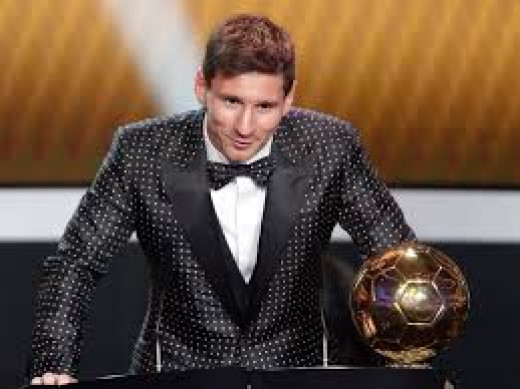 Messi posed with one of his Golden ball Award