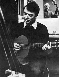 Jake Thackray with guitar and cigarette