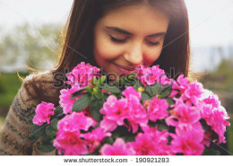 Woman smelling blooms.