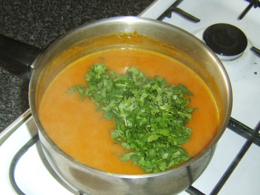 Chopped coriander leaf is added to celery and onion squash soup