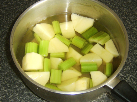 Chopped celery and potato in vegetable stock