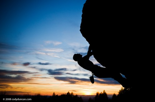 A gorgeous sunrise finds this rock climber already climbing his target rock.