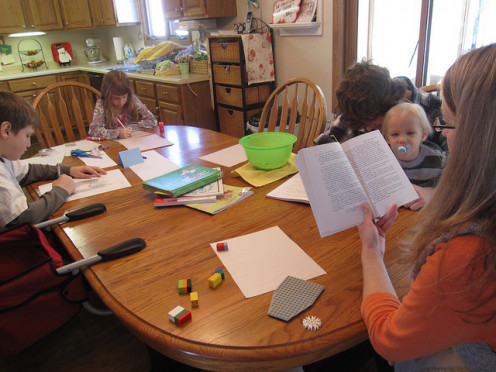 A typical homeschooling family at work.
