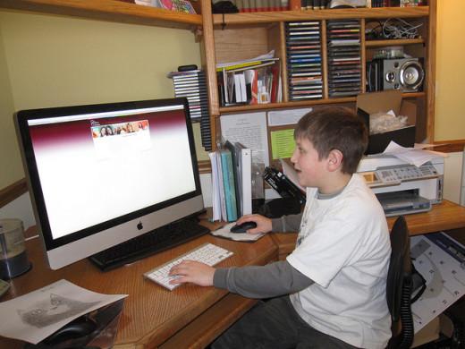 Homeschooling student using desktop computer.
