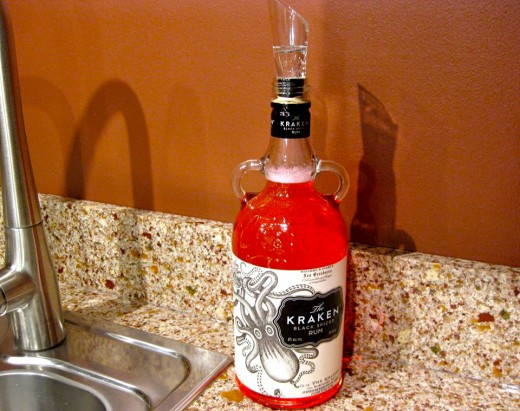 An old Kraken Rum bottle containing dishwashing soap. The wine spout controls the pouring speed.