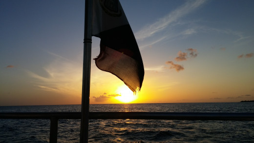 Dutch (Netherlands Flag) on Lambada sunset cruise resting in sunset