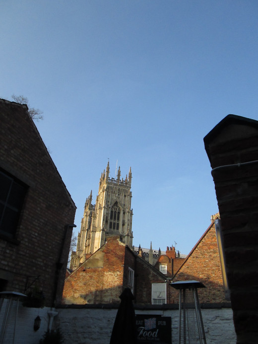The western front of the cathedral seen from the beer garden of Ye Old Starre Inn on nearby Stonegate