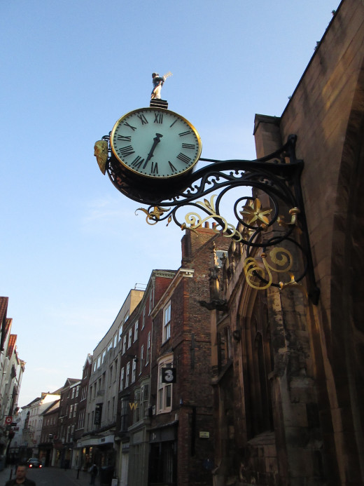 The Saint Martin clock that overhangs Coney Street dates from 1668, attached to the wall of the priory that was destroyed by bombs August Bank Holiday, 1942