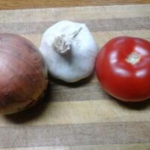 A sweet onion, garlic clove and organic vine ripened tomato.