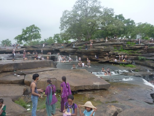 People enjoy bathing under water falls, cooking food and celebrating with family and friends under the trees during the autumn season