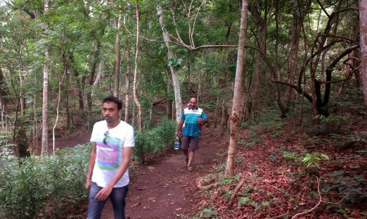 My son and his friend walking through the hilly paths to reach the picnic spot